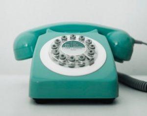 Turquoise old style telephone